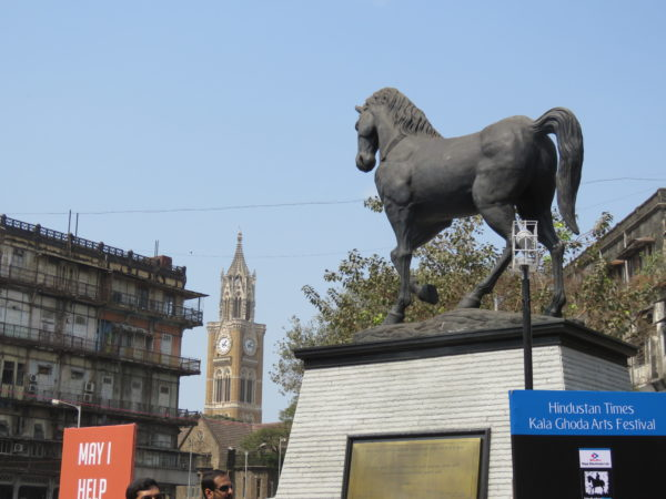 New Statue installed in 2017 as symbol of Kalaghoda. Watson Hotel & Rajabhai Tower in background.